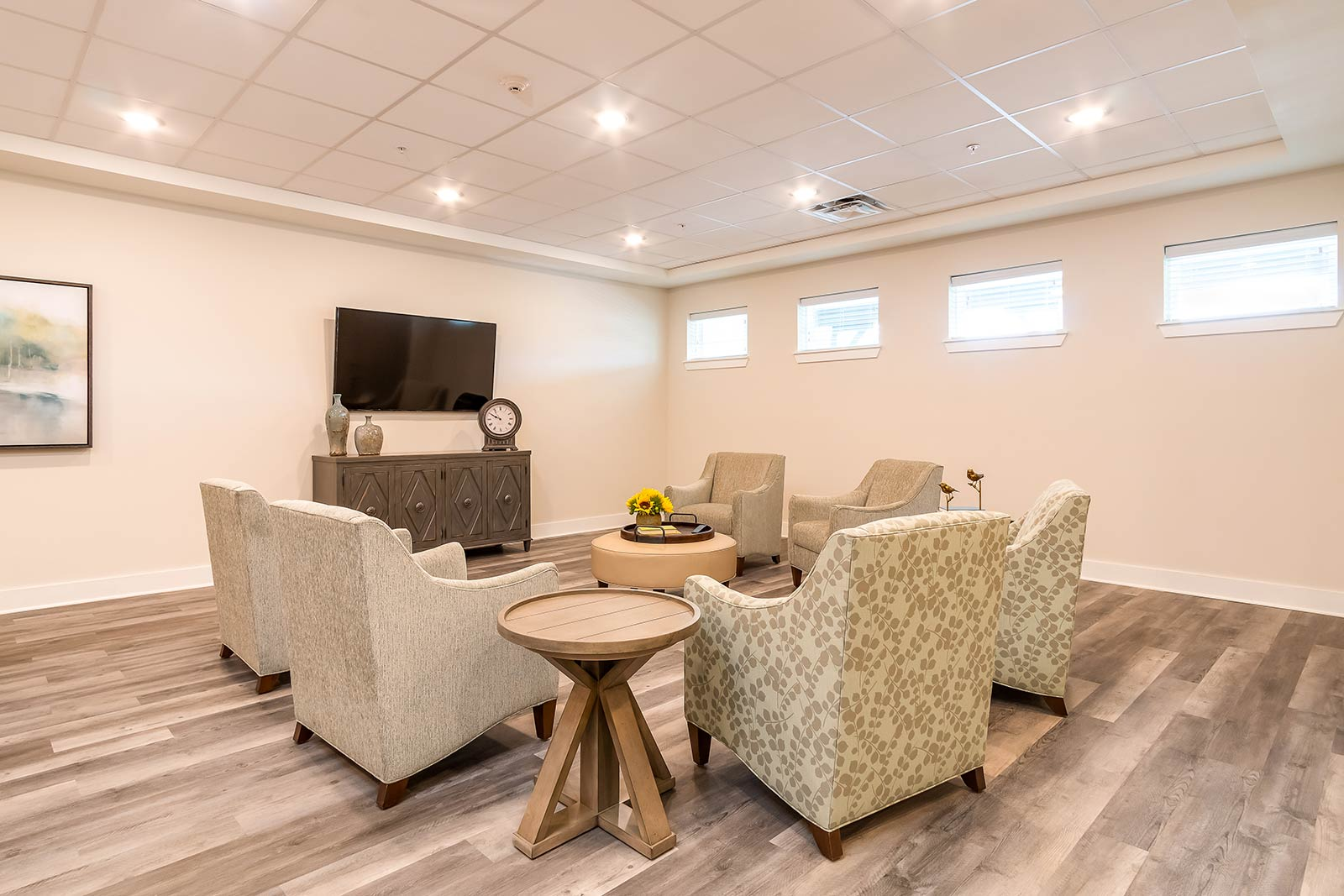Lounge area with TV, couches and chairs in our Plant City FL assisted living and memory care community